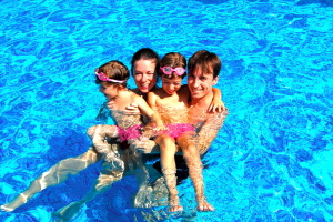 Family enjoying the heated pool