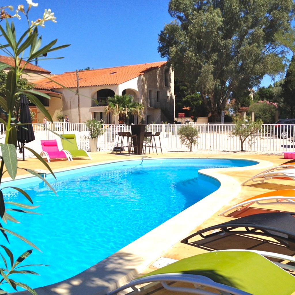 Pool with view of Aigrette and Cormoran Apartments Imagine Roussillon